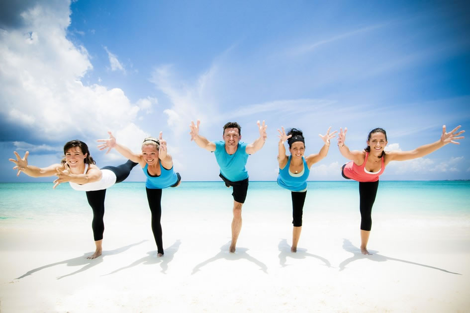 The Bliss Yoga Crew in warrior 3, Cayman Islands