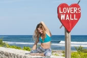 Annie, at Lovers Wall on East End, Cayman Islands