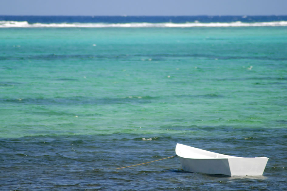 White boat and the Barrier Reef, East End, Grand Cayman