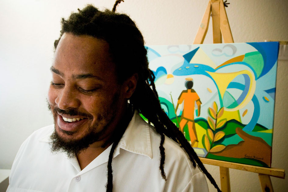 Caymanian artist Gordon Solomon with one of his paintings
