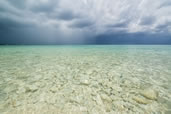 Storm over the crystal clear waters of Seven Mile Beach