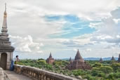 Burmese man looks out over the ancient temples, Bagan
